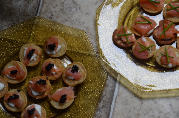 Blinis with caviar smoked salmon and creme fraiche