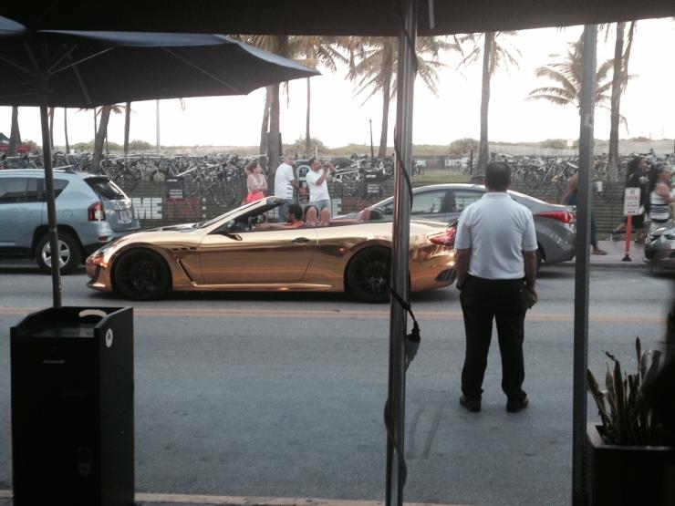 gold car ocean drive miami
